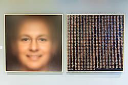 """Das kollektive """"Willkommensgesicht"""" und die Einzelporträts hängen jetzt im Welcome Center Stuttgart (Foto: Martin Lorenz, Künstler: Wolf Nkole Helzle)"""